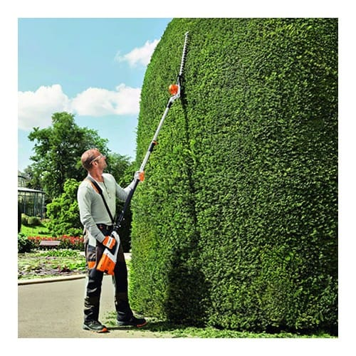 Stihl HLA 85 Cordless Long-Reach Hedge Trimmer in use