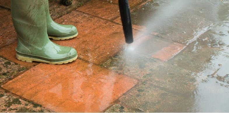How to clean patio slabs with detergent, bleach and a pressure washer