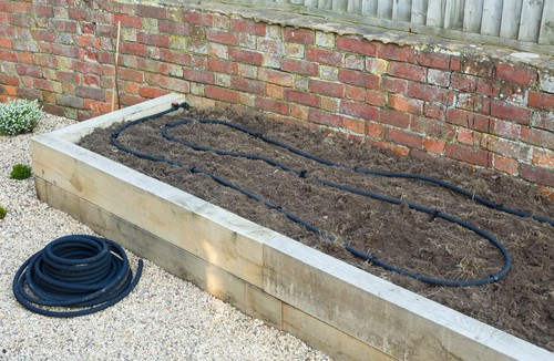 Installing a soaker hose in raised bed