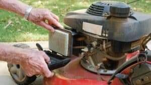 Lawn mower engine being serviced