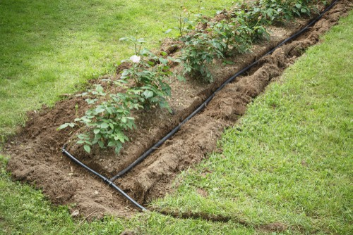 soaker hose installed in trench before being covered with soil.